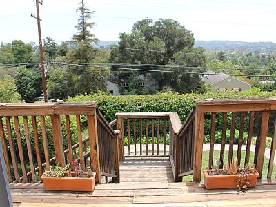 Deck Stairs To Fenced Backyard Below